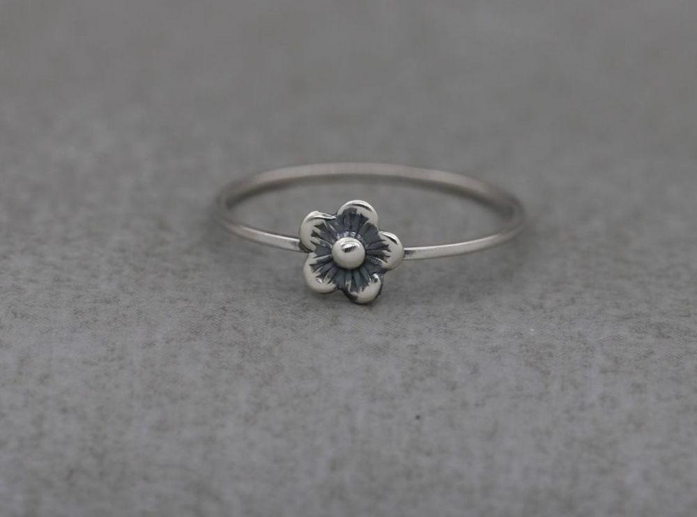 Delicate handmade sterling silver flower ring
