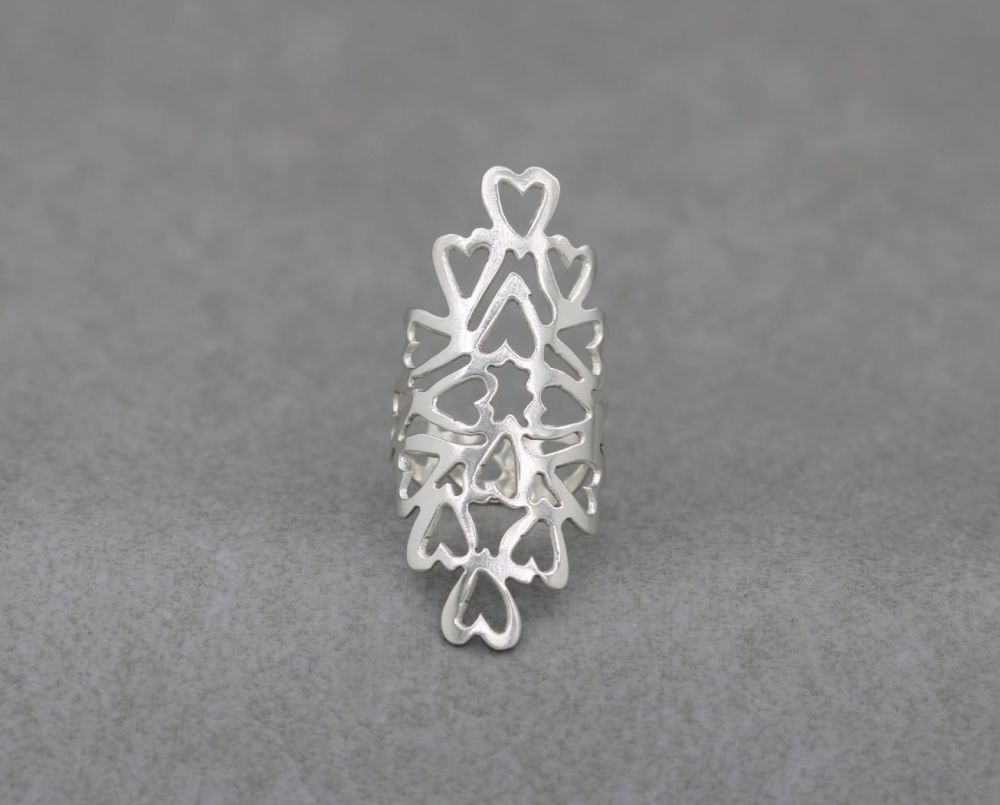 Long handmade sterling silver cut-out hearts ring