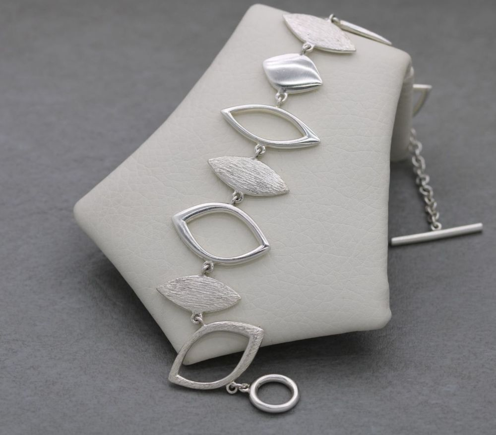 Wide sterling silver toggle bracelet with textured detail
