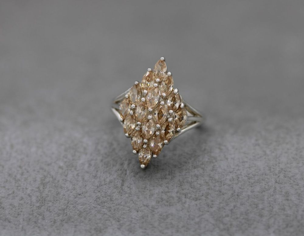 Long sterling silver cluster ring with peach marquise stones