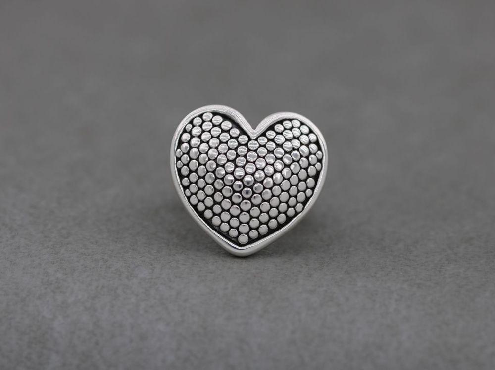 Bold sterling silver dotty heart ring