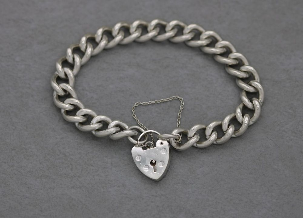 Vintage sterling silver charm bracelet with heart padlock clasp and safety chain