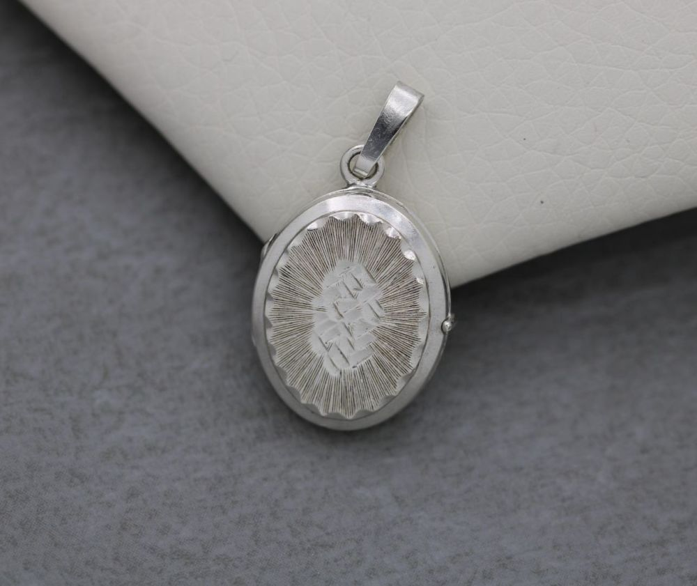 German sterling silver double-sided engraved oval locket