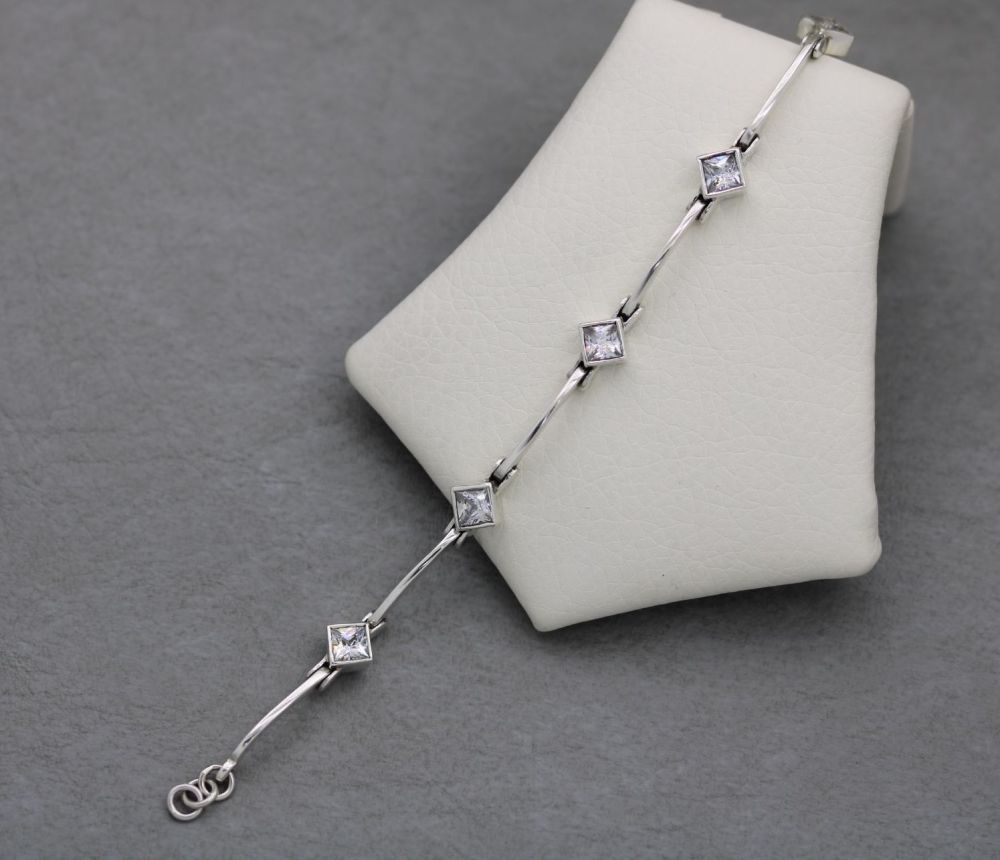 Sterling silver bracelet with faceted clear square stones