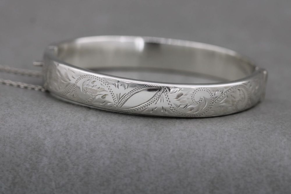 Vintage sterling silver engraved bangle with safety chain
