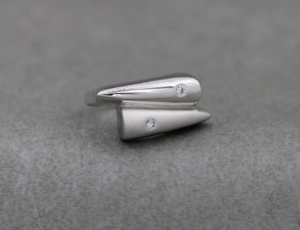 Bold sterling silver bypass style ring with matt detail & clear stones