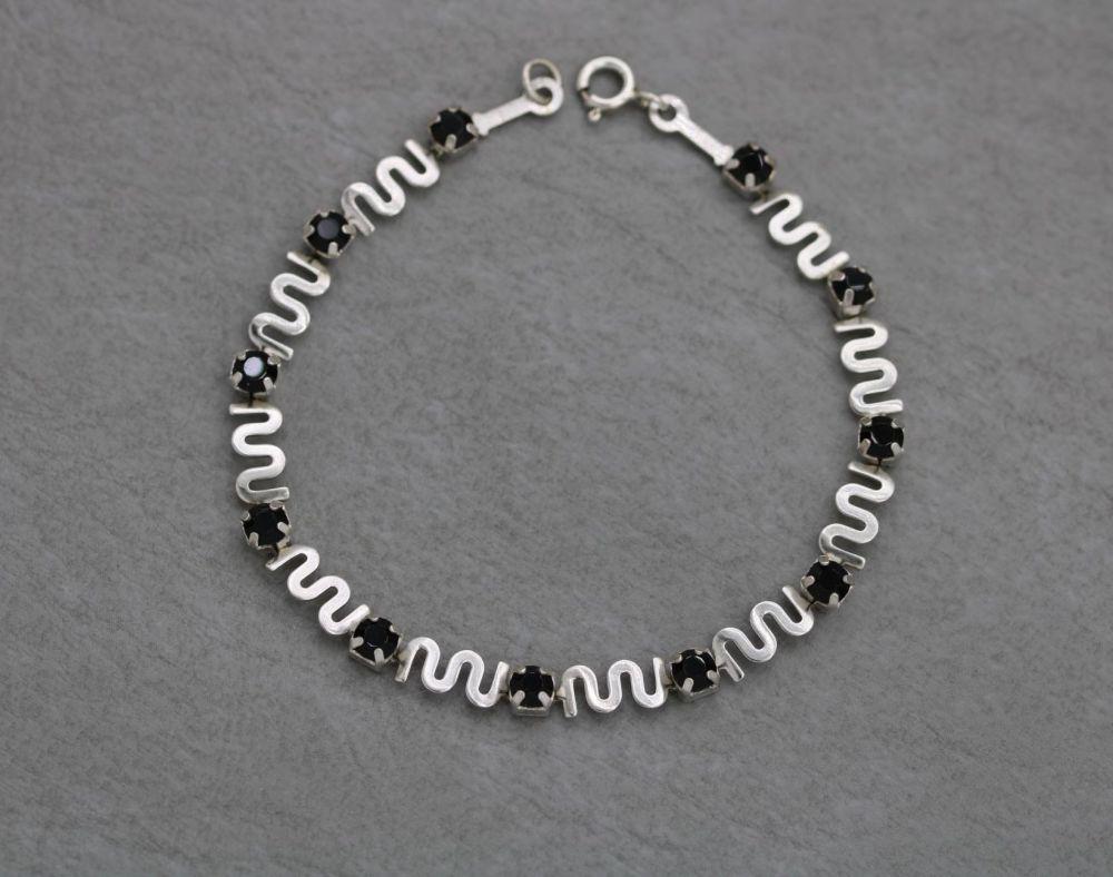 Fancy vintage sterling silver bracelet with waves & black faceted stones