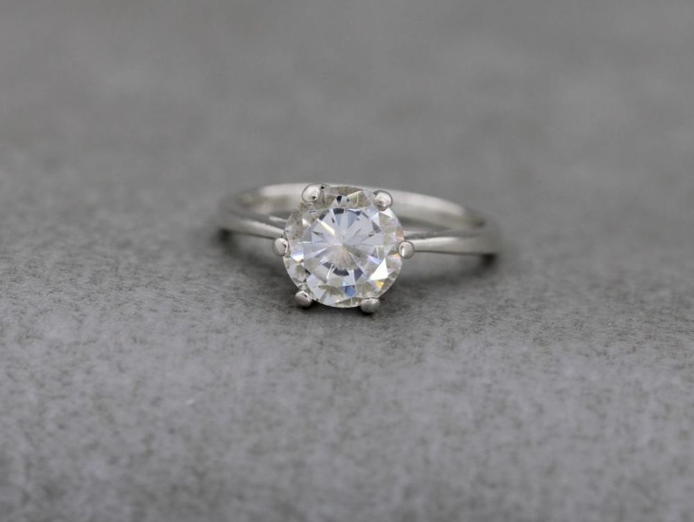 Proud sterling silver & faceted clear stone solitaire ring