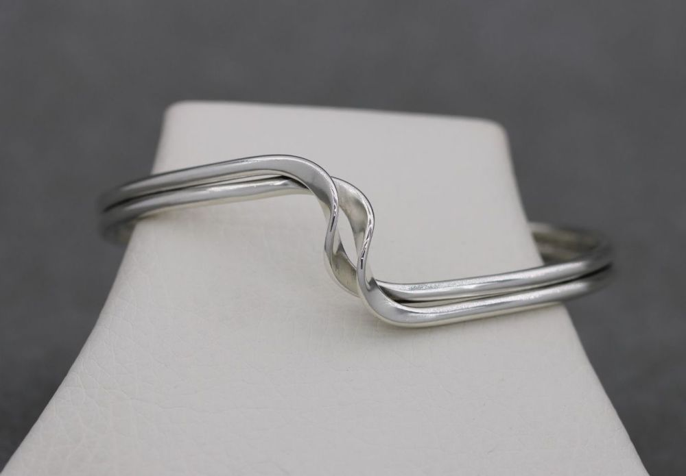 Sterling silver double strand cuff with a twist