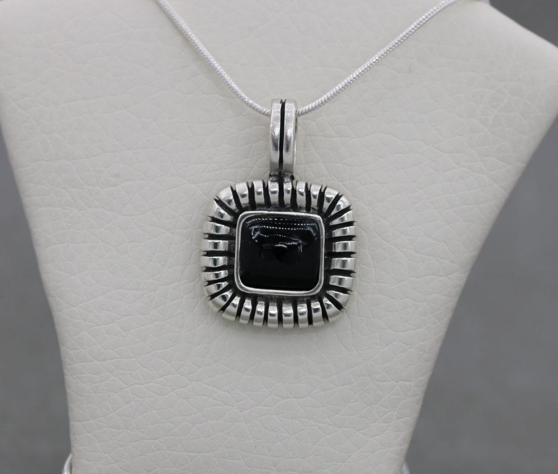 Sterling silver & black onyx necklace with a decorative frame