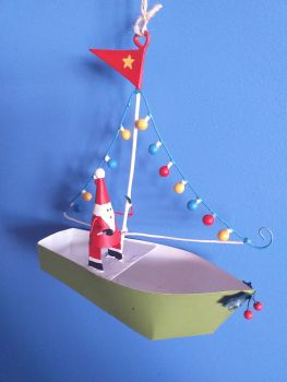 Metal Santa in Boat with Lights
