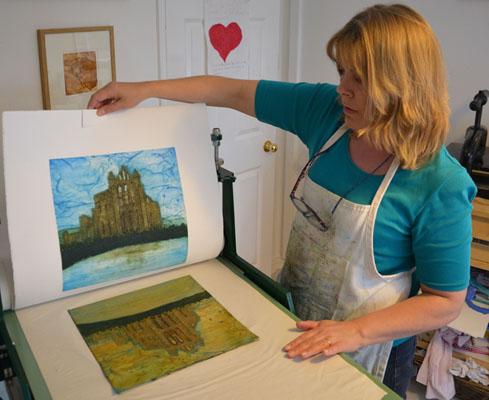 Jane Duke pulling a print