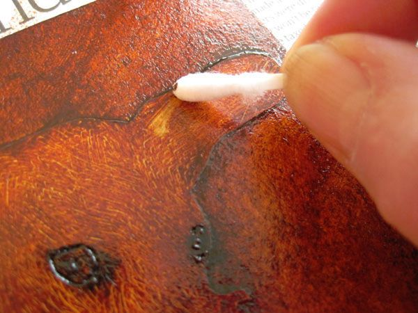 wiping a collagraph plate