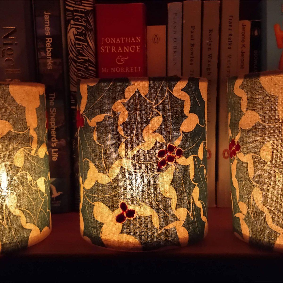 holly lanterns lit