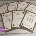 champagne glitter with purple roses table numbers with song quotes