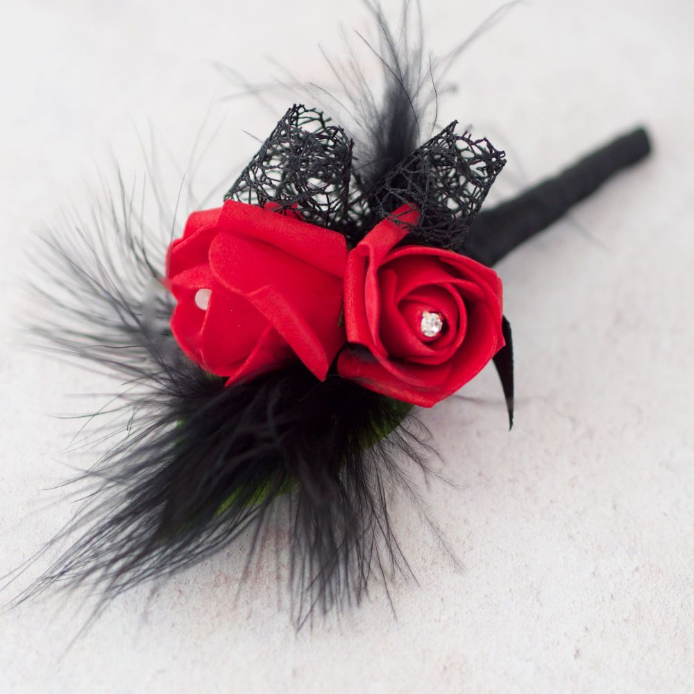 <!--055--> Red Foam Rose With Black Feather Gothic Style Wedding Buttonhole