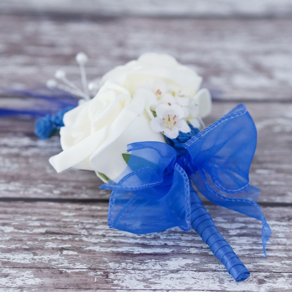 <!--065-->Ivory Foam Roses Royal Blue Feathers Silver Pearl Wedding Corsage