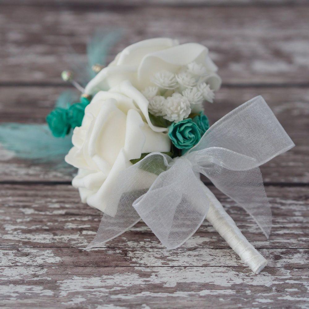 <!--095-->White Foam Roses Turquoise Feathers Silver diamante wedding Corsa