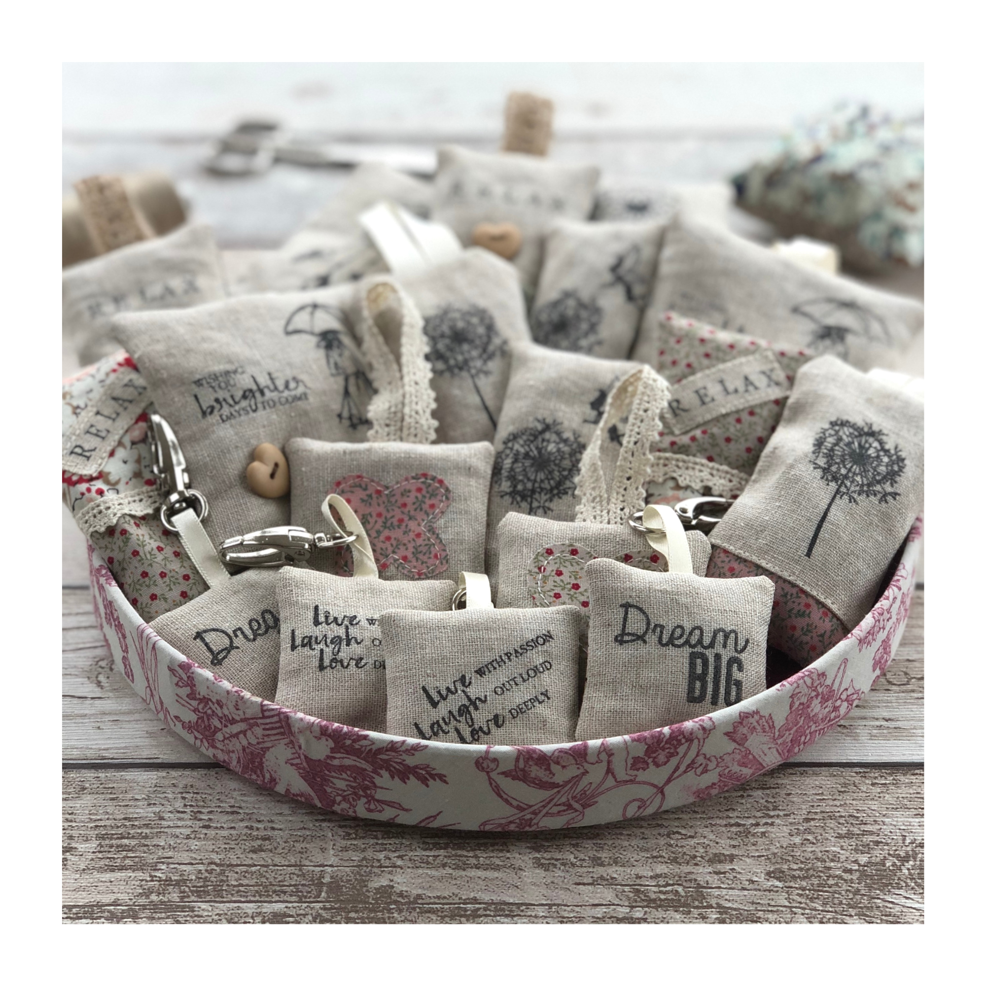 Mini lavender pouches made in linen with stamped images and contasting cotton fabric