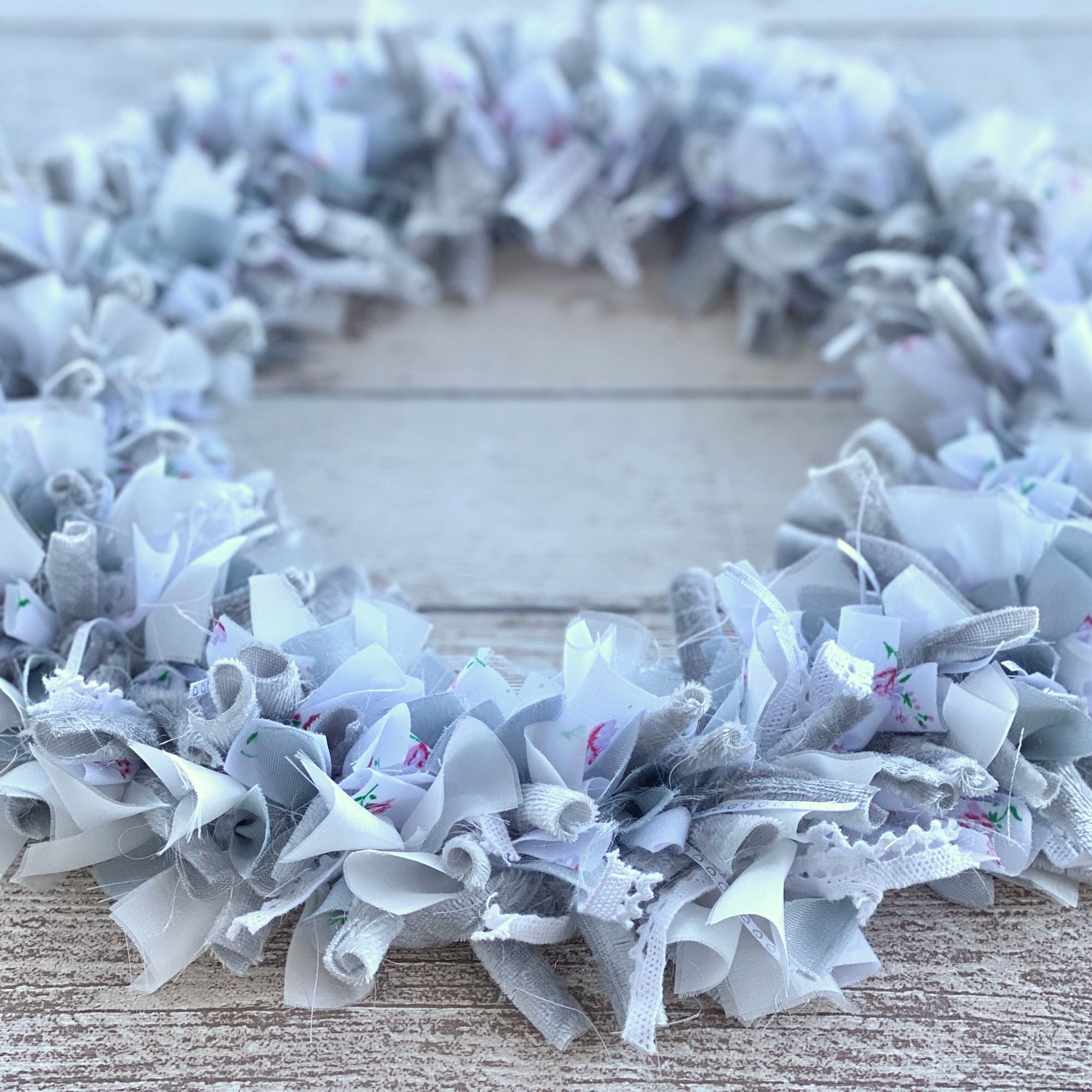 A white and silver fabric scraps wreath