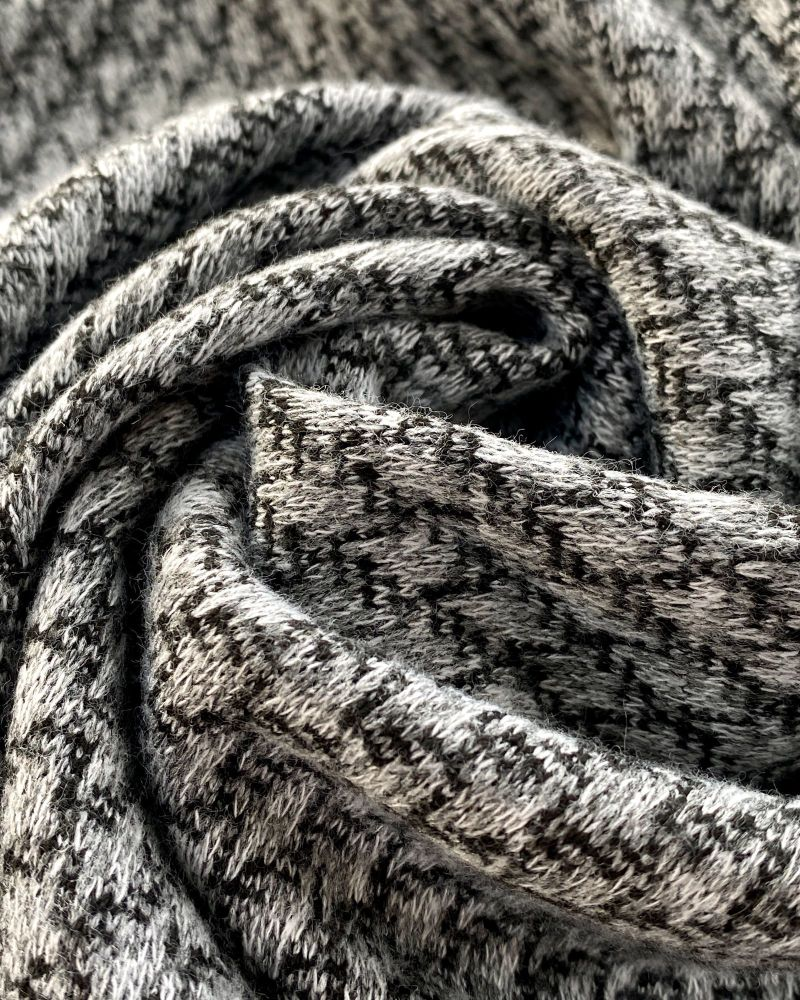 Soft shades of grey textured wool looking fabric swirled into a central loop.  Photo by Just Sew Helen