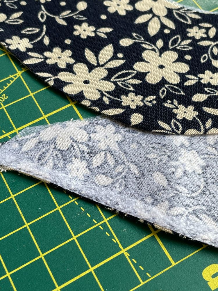 A fabric neck facing with a hemmed finished edge