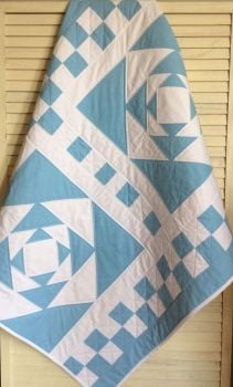 Blue and White Exploding Block Baby Quilt