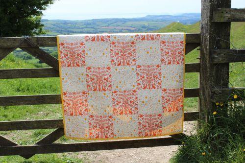 Baby Quilt - Folklore Otomi Orange and Windswept Iota Sun
