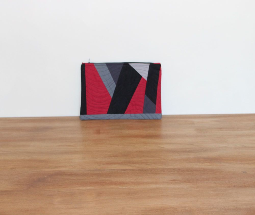 A Dorset Patchworks Bits and Bobs Quilted Pouch (Grey, Red and Black Abstra