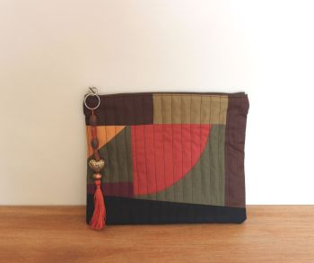 A Dorset Patchworks Bits and Bobs Quilted Pouch (Dark Hues - Curved)