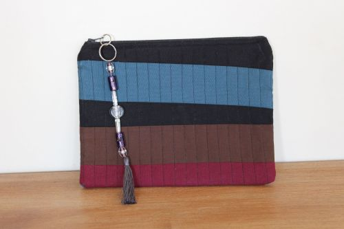 A Dorset Patchworks Bits and Bobs Quilted Pouch (Dark Stripes)