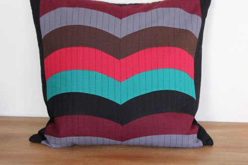 Multi-Coloured Quilted Zippered Cushion (Curves)