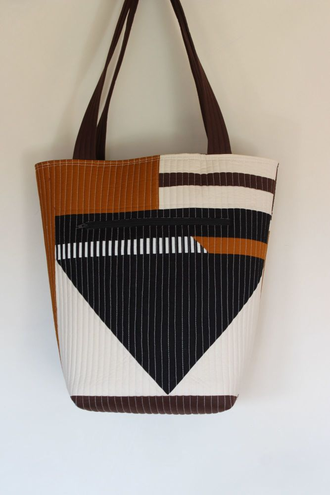 0e554c731 A modern tote bag using a combination of Kona Cotton solids and some black  and white striped fabric. The bag has two two zippered pockets, ...
