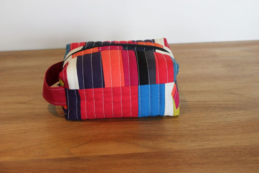 A Dorset Patchworks Bits and Bobs Quilted Box Pouch (Abstract Red and Black