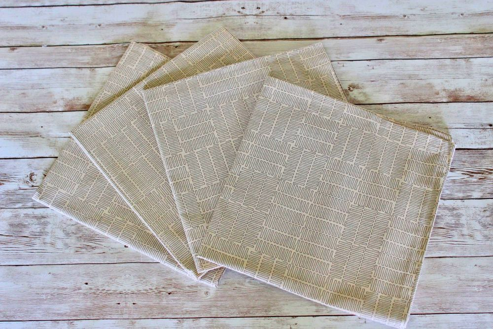 Set of Four Wayside Napkins in Natural and Grey with Silver Metallic Lines