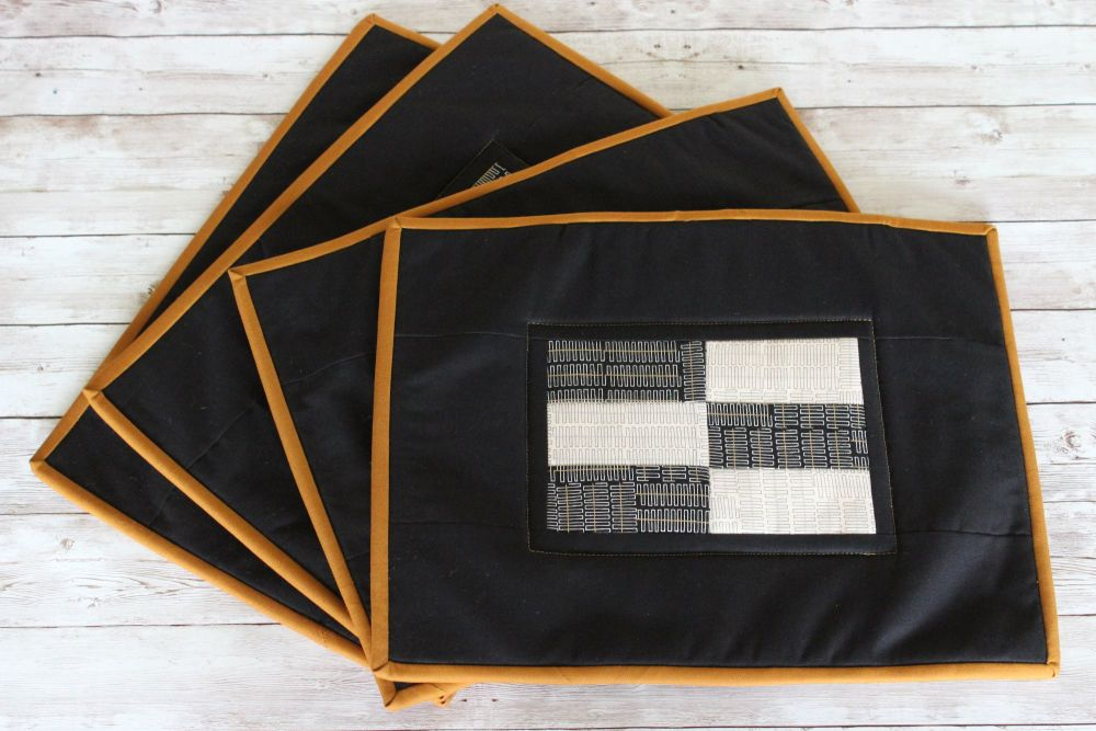 Set of Four Black and Natural Wayside Quilted Place Mats