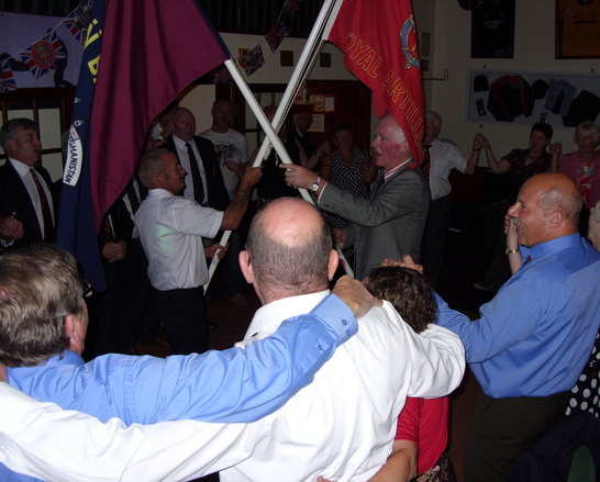 Donald Hawes with flag at the 2010 reunion