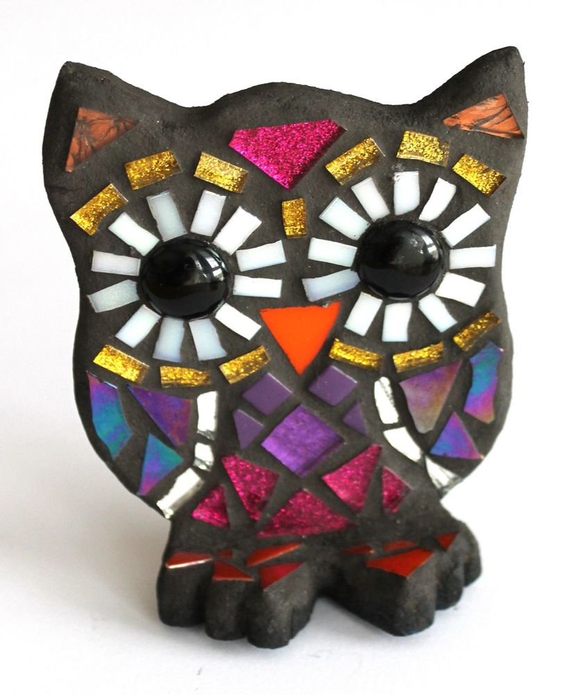 Small purples and pinks standing owl
