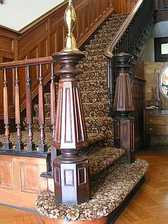 Newel post at foot of main staircase at Cheltenham Park Hall