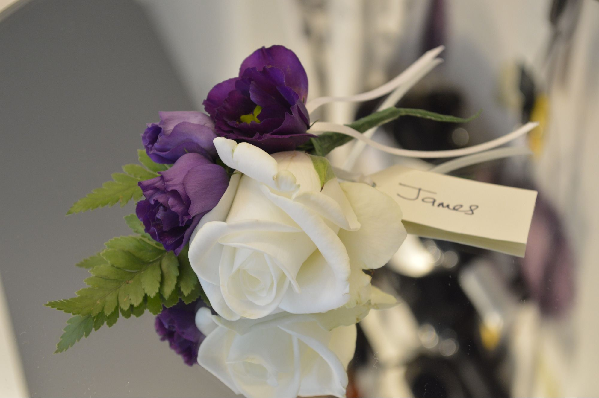 Ivory cream and purple buttonhole corsage