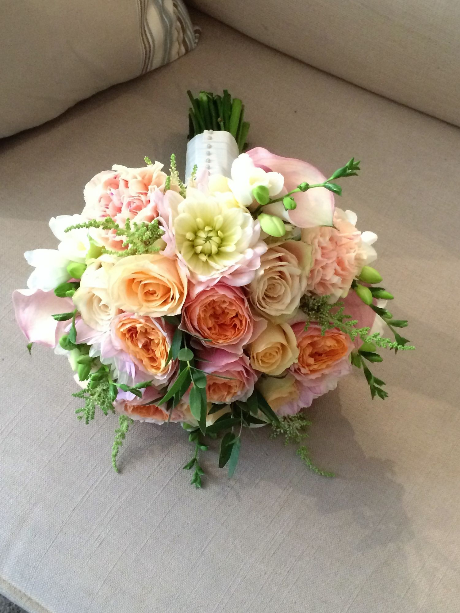 Brides hand tied bouquet lilac pink cream