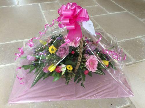 Handled Basket fresh seasonal flower arrangement - available in either cust