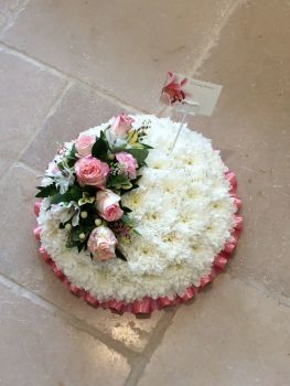 "Funeral tribute - based posy pad - white, yellow or pink chrysanthemum based with flower spray - 9"", 12"", 14"" or 16"" - From £30.00"