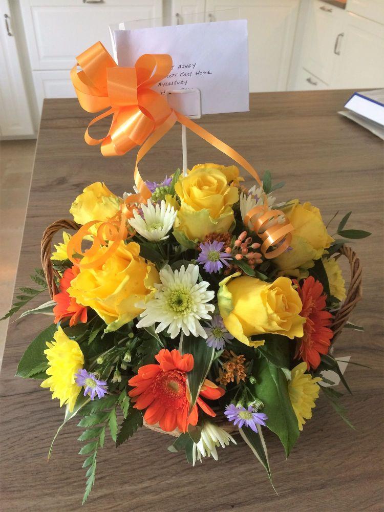 Round Basket fresh seasonal flower arrangement - various Rose colours or a