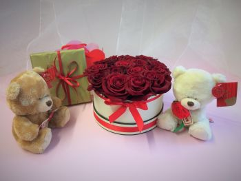 2. Luxury fresh roses in a round ivory box, guarantee a spectacular effect on a Special Occasion - From £35.00