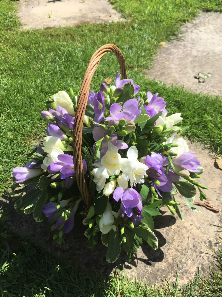 Handled Basket fresh seasonal flower arrangement - available in either cust