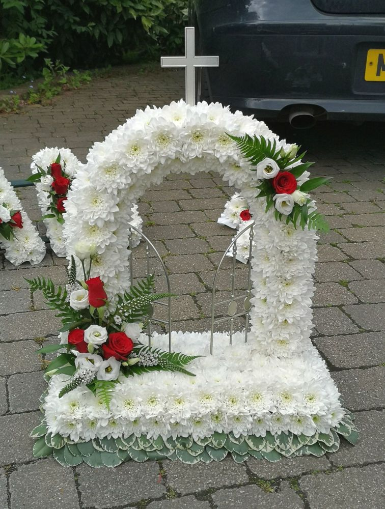 Traditional Funeral Tribute - Open Gates Of Heaven wreath - foliage edge