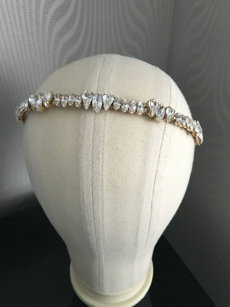 Set of two gold headbands.