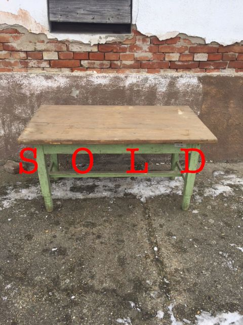 Woodn table with green legs