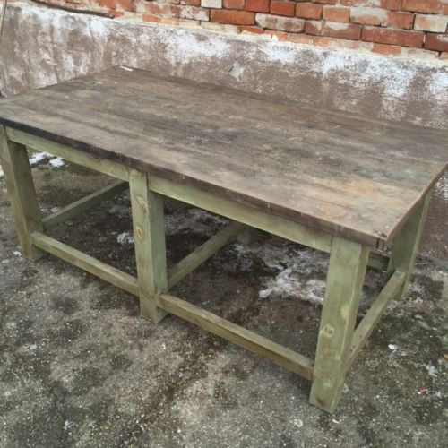 wood table with green base/legs